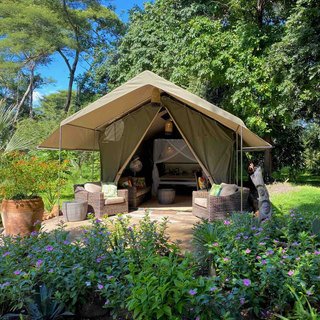 Wooland tent with veranda at Waterberry Lodge on the Zambezi close to Victoria FallsEach Woodland tent has a veranda garden with sun loungers
