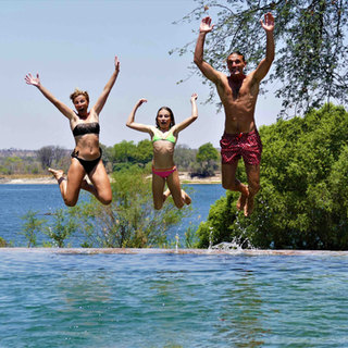 Family friendly infinity pool at River Farmhouse at Waterberry Lodge, Zambia