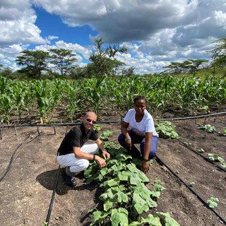Proudly examining the first crops from the community farm at Tukongote supported by Waterberry Lodge, Livingstone, Zambia