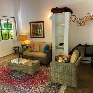 Lounge area and luggage storage space in room at Waterberry Lodge