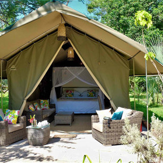 Each Woodlands tent has comfortable patio furniture for watching birdlife in perfect peace and quiet at Waterberry Lodge on the Zambezi.