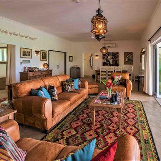 Lounge overlooking the infinity swimming pool and the Zambezi at Waterberry Lodge