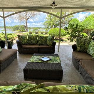 Plenty of stylish, comfortable outside lounging furniture at River Farmhouse, Waterberry Lodge, Zambia