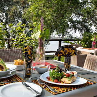 Dining on the terrace overlooking the Zambezi at Waterberry Lodge