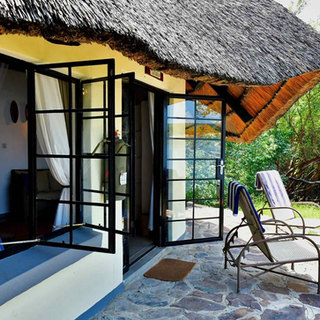 All cottages have private terraces at Waterberry Lodge