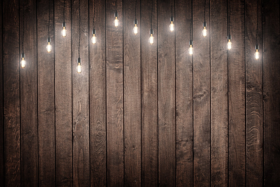 Light bulbs on dark Wooden Background .j