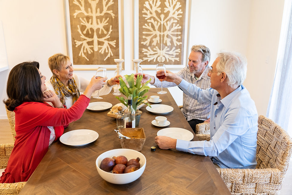 Residents enjoying a glass of wine in their premium villa at La Dimora Retirement village