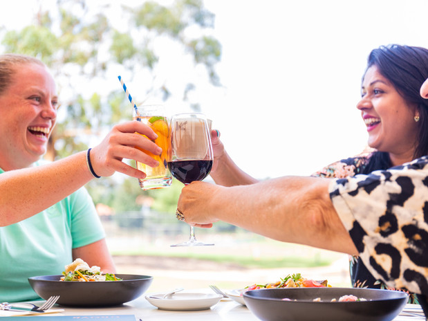 Guests cheersing on the terrace at The Grove at Hidden Valley resort country club 45 minutes from Melbourne
