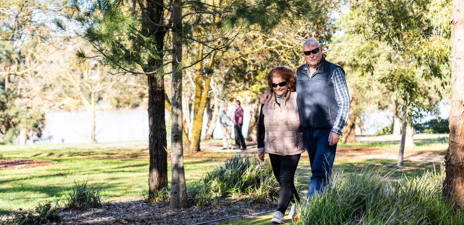 residents enjoying a walk in the picturesque surounds of La Dimora retirement village