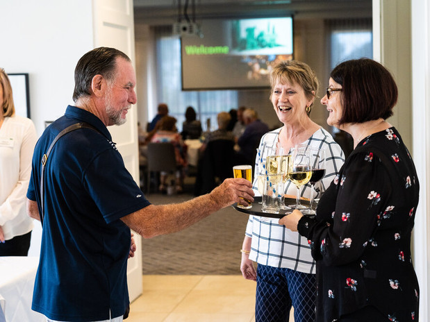 guests recieving a glass of champagne upon entry into a corprate function at Hidden Valley resort and country club 45 minutes from Melbourne