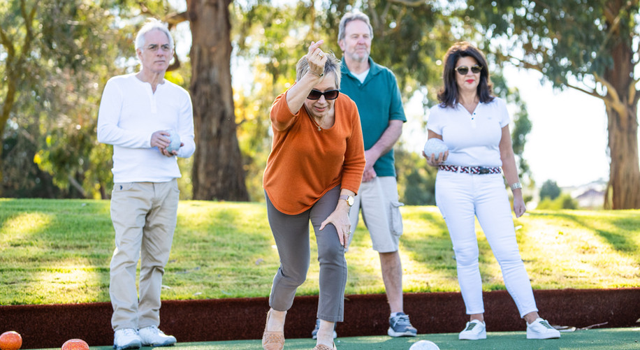 residents playing lawn bowls at hidden valley resort as oart of the premium facilities at La Dimora retirement village