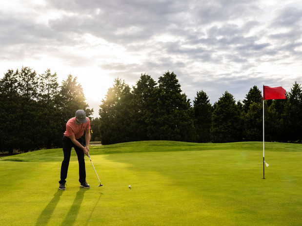 Having a putt at sunrise on the 18 hole PGA championship golf course at Hidden Valley resort and country club 45 minutes from Melbourne