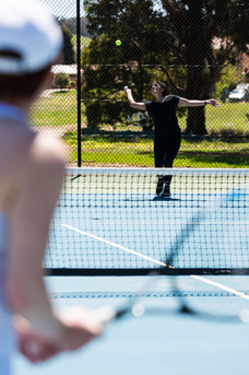 Country Club members enjoying the premium tennis courts at Hidden Valley resort country club in Wallan Victoria