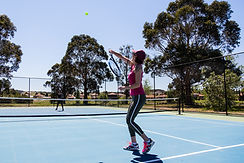 Country club members enjoying the state of the art tennis courts at Hidden Valley Resort 45 minutes from Melbourne