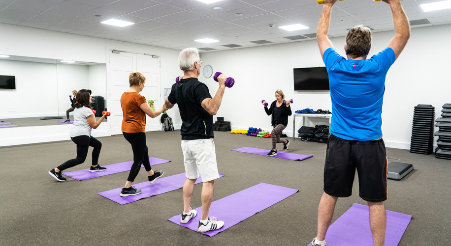 residents from La Dimora Retirement Community partisipating in a group fitness lesson in the gym at Hidden Vallery Resort