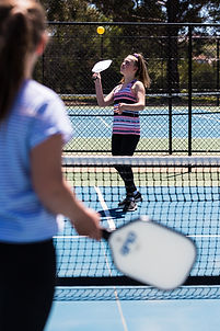 Young country club members playing a game of pickleball on the State of the art courts at Hidden Valley resort Wallan Victoria