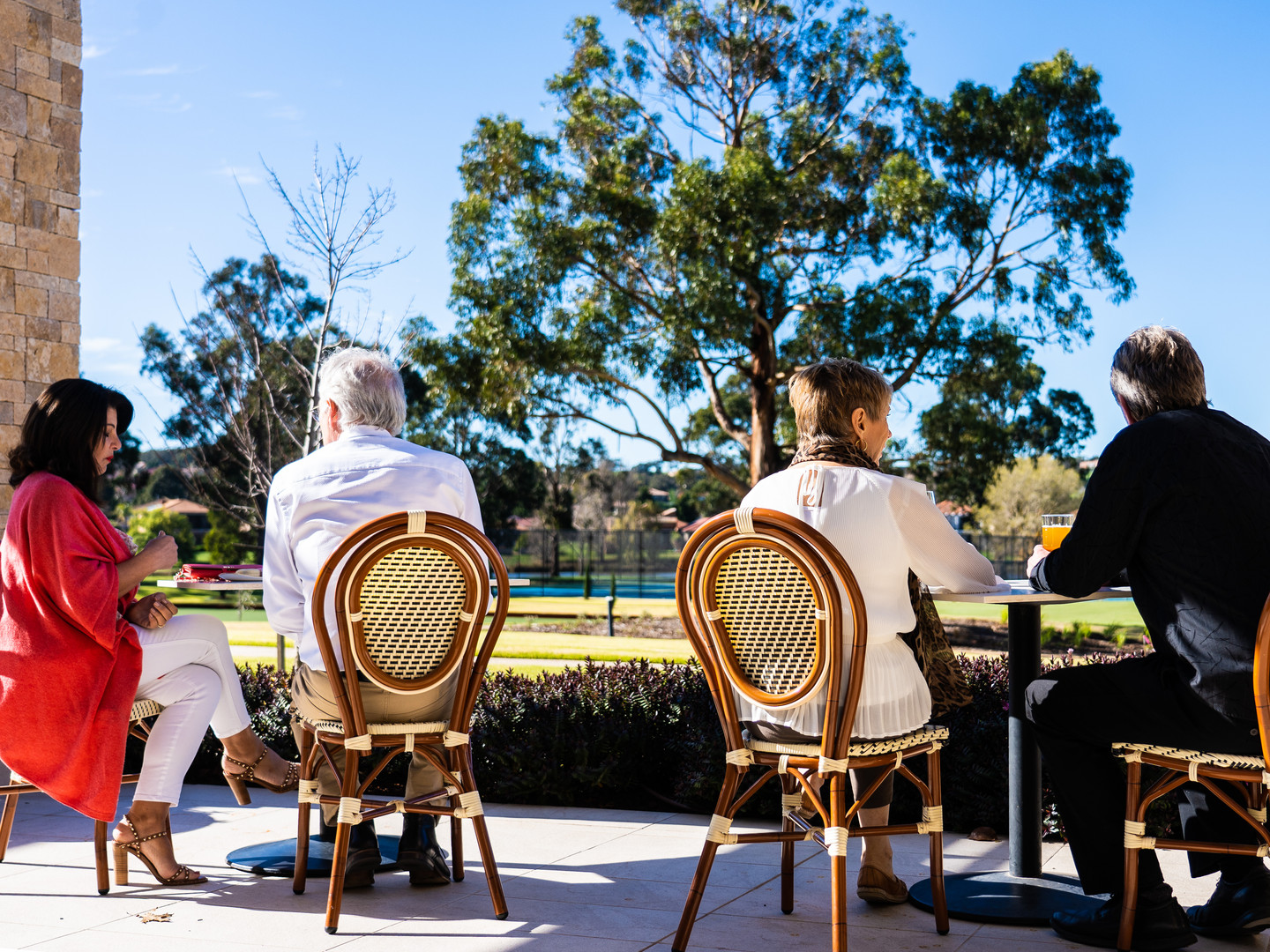 People enjoying the afternoon sun on the terrace of The Grove at Hidden Valley Resort near Wallan Victoria