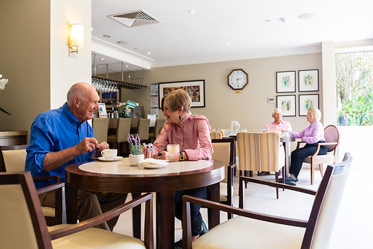 Residents enjoying a cup of coffee at the premium cafe at Rylands of Hawthorn in Melbourne's inner east