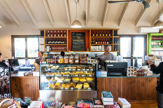 Mount Macedon Trading Post front bar and food display with Clare and Brad working the bar