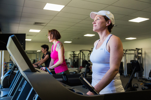Country club members enjoying the state of the art gym facilities at Hidden Valley resort 45 minutes from Melbourne