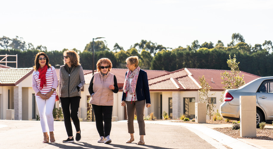 Residents walking past the luxury villas at La Dimora Retirement Resort just 1 hour north of Melbourne