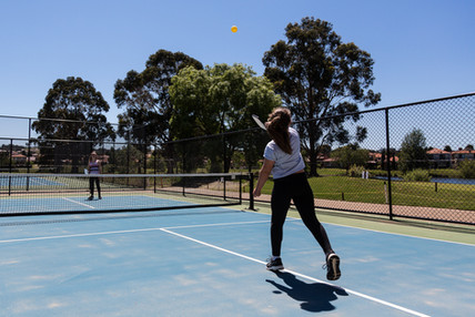 Country club kids enjoying the premium tennis courts at Hidden Valley resort near Wallan Victoria