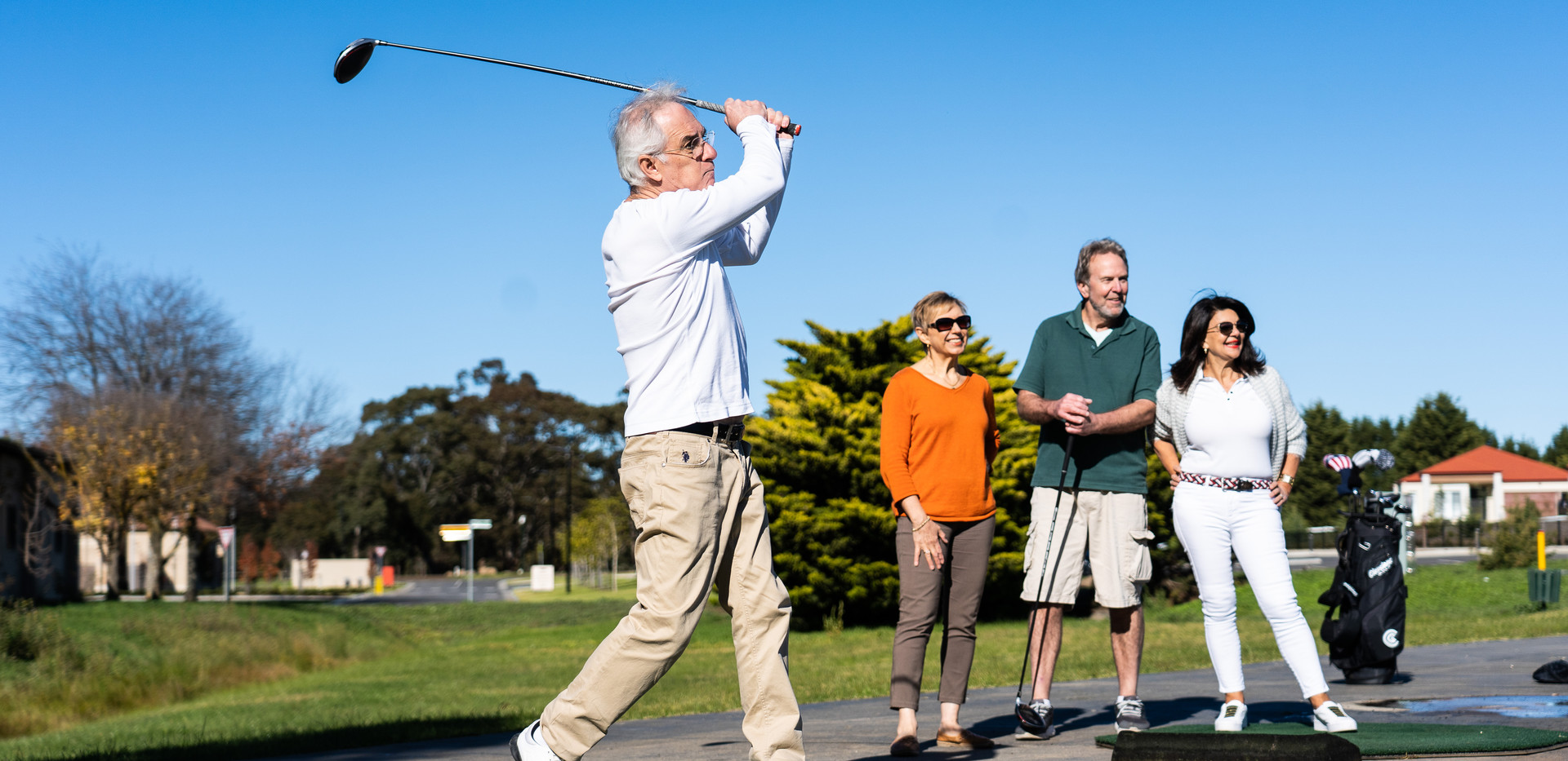 Residents from La Dimora retirement community  practicing their golf on the driving range
