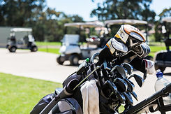 Set of golf clubs with golf carts in the background at Hidden Valley Resrot country club near Wallan Victoria