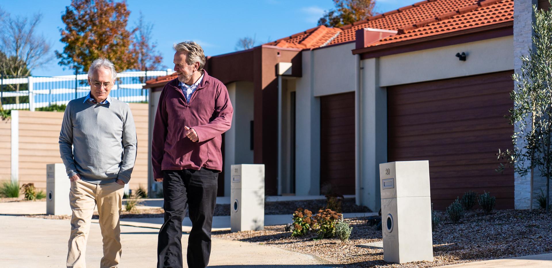 residents walking past the luxury villas at La Dimora Retirement Village 1 Hour North of Melbourne