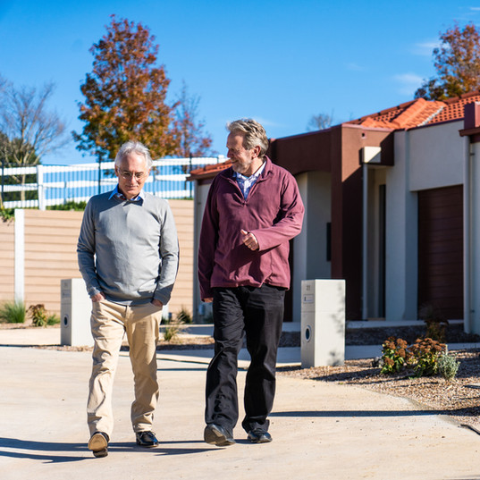 residents out on an afternoon walk outside the luxury Villas at La Dimora retirement village 1 hour north of Melbourne
