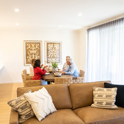 Luxury open plan living and kitchen area with residents enjoying lunch at La Dimora retirement community in Hidden Valley Wallan Victoria