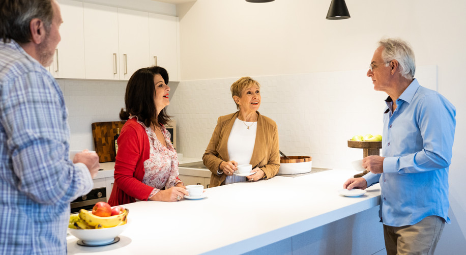Residents in the kitchen of a luxury villa at La Dimora Retirement Village just one hour north of Melbourne