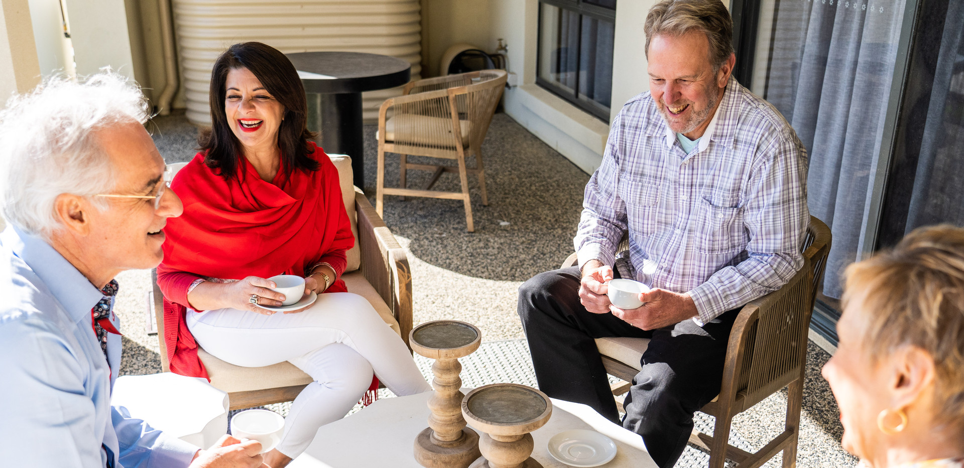 Residents enjoying a cuppa on the terrace of a luxury villa at La Dimora Retirement Resort 1 Hour north of Melbourne