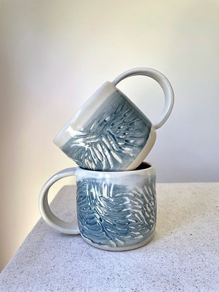 Pair of Carved Blue Mugs