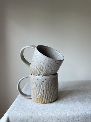 Pair of Carved White Mugs
