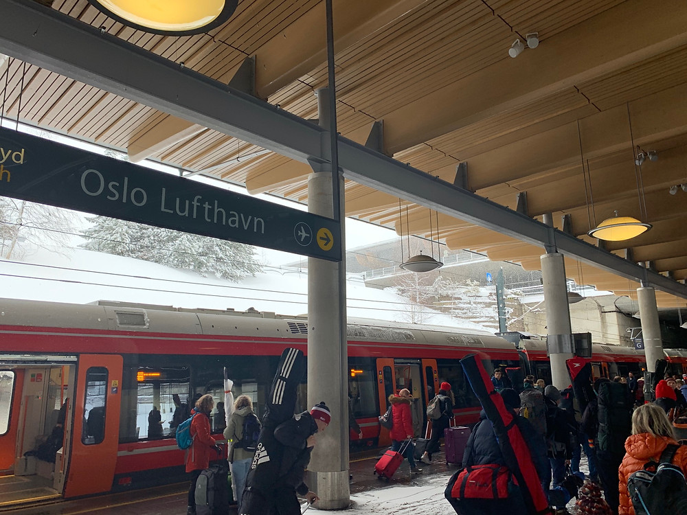 Train with skiers at Oslo Lufthavn station.