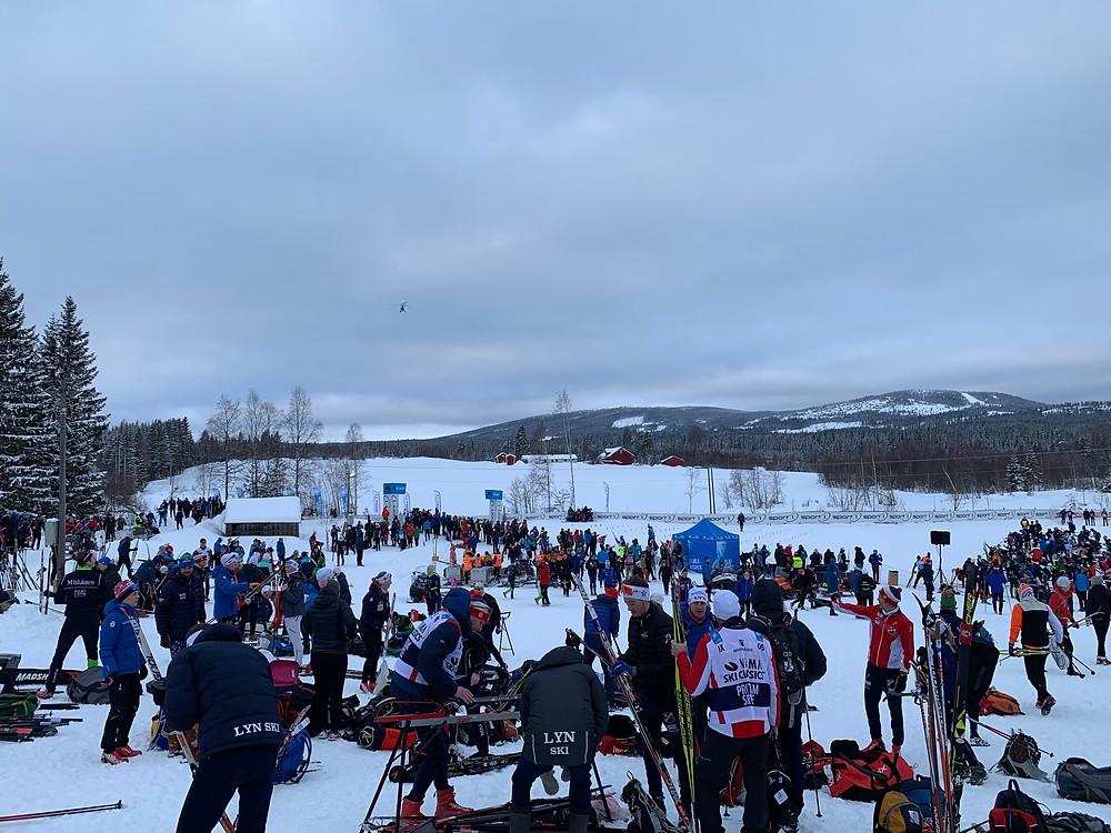 Skiers milling around the Birkebeinerrennet starting area in Rena, Norway.