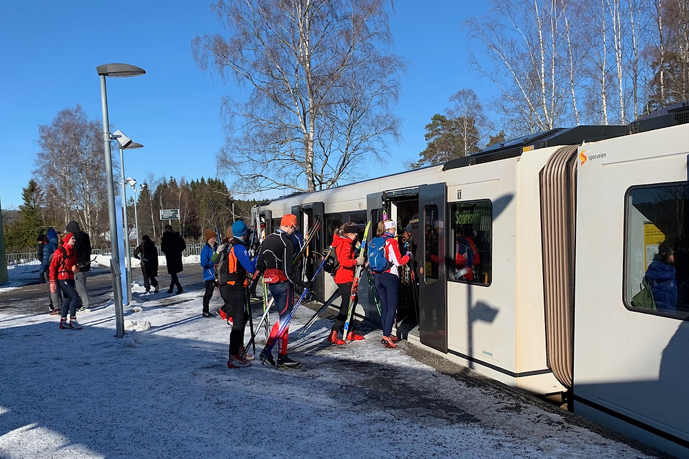 Cross country skiers in Oslo traveling to the Sognsvann trails via train.
