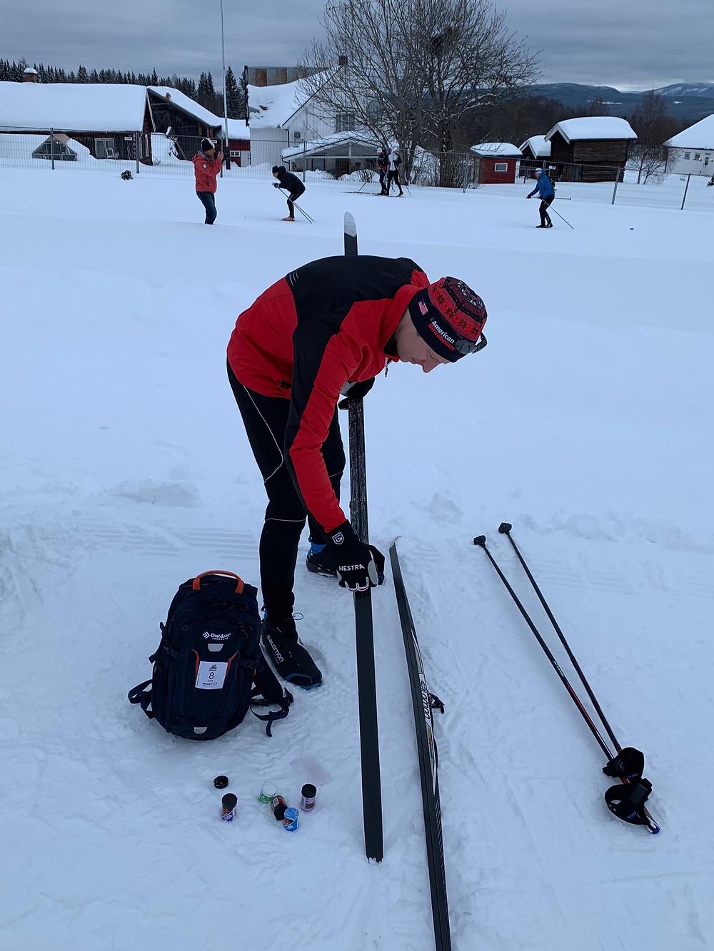 Skier applying ski wax in Rena, Norway, the Birkebeinerrennet