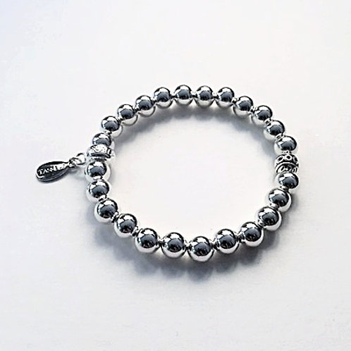 Silver brass and Tibetan bead bracelet with tassel charm carrier
