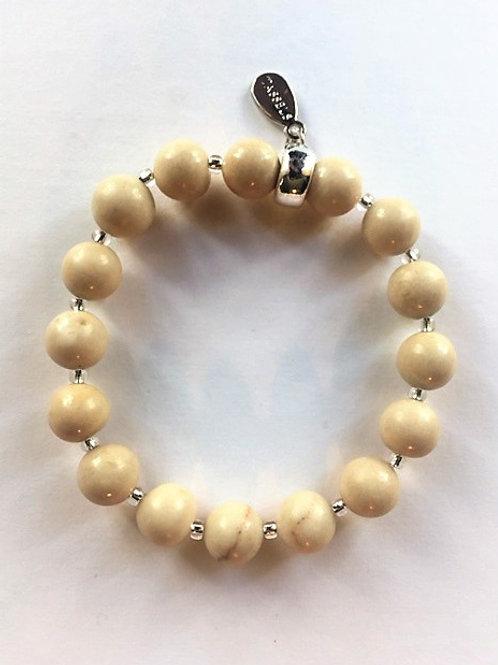 Fossil bead bracelet with charm tassel carrier