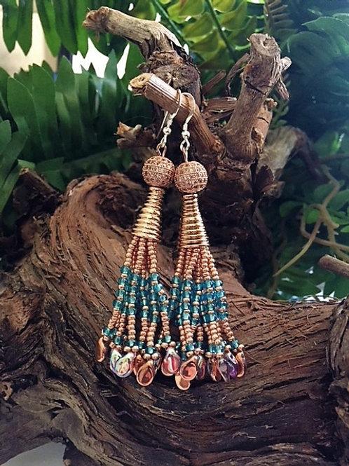 fushia over the top tassel earrings