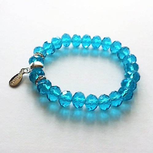 turquoise blue faceted glass bead bracelet with tassel carrier