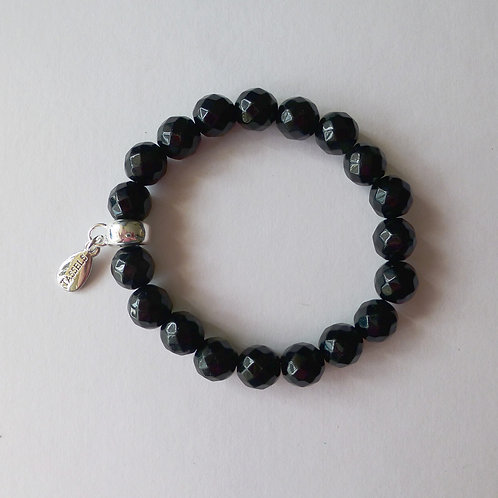Black onyx bead bracelet with charm tassel carrier