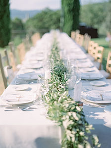 Golden evening light kisses the couples chic wedding table styled by Quintessently London