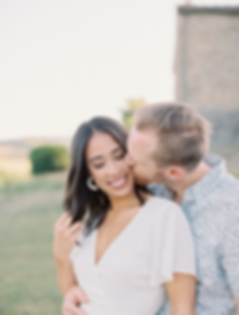 A couple in love kissing on their wedding portrait session