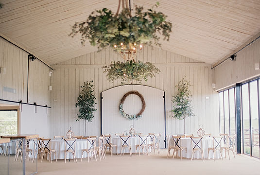 Wedding Photography at Primrose Hill Farm in Oxfordshire. Photo of stunning light filled wedding hall overlooking the countryside