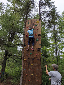 Lady rock climbing