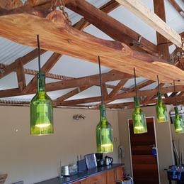 Rustic hanging light for outdoor break area.