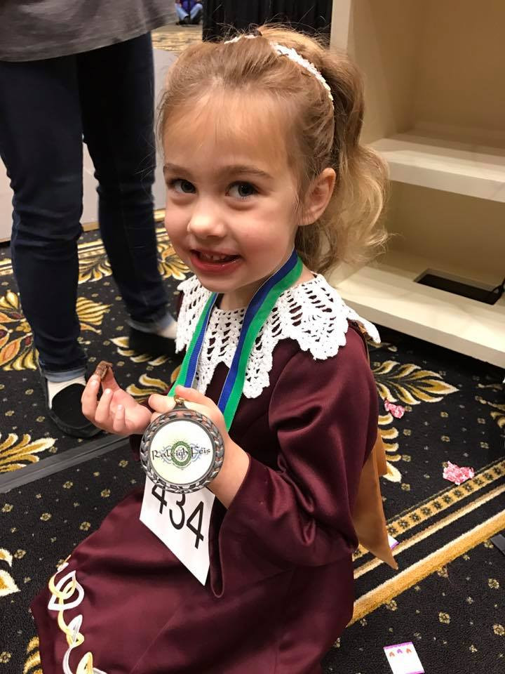 One of our beginners showing off her new medal!